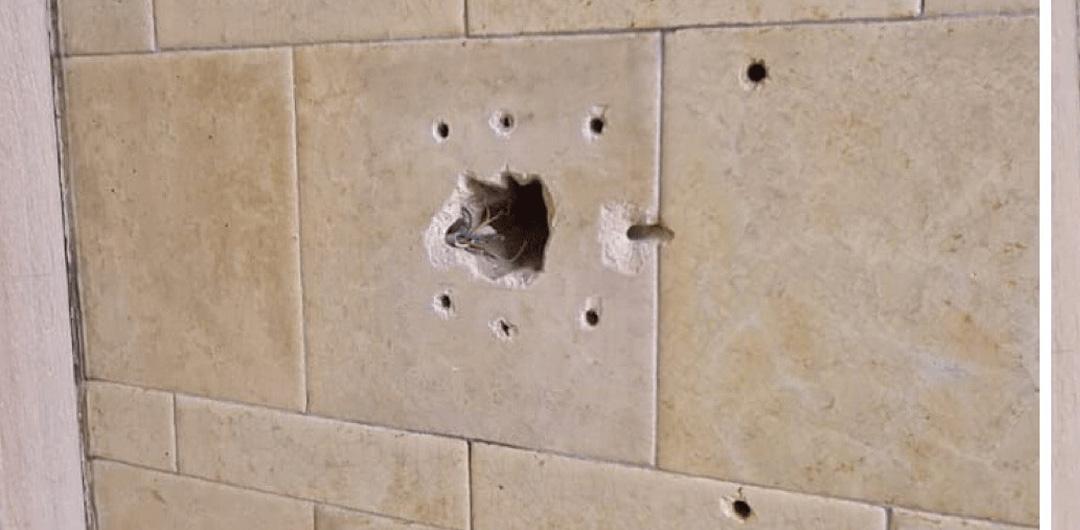 Damaged tile before repair