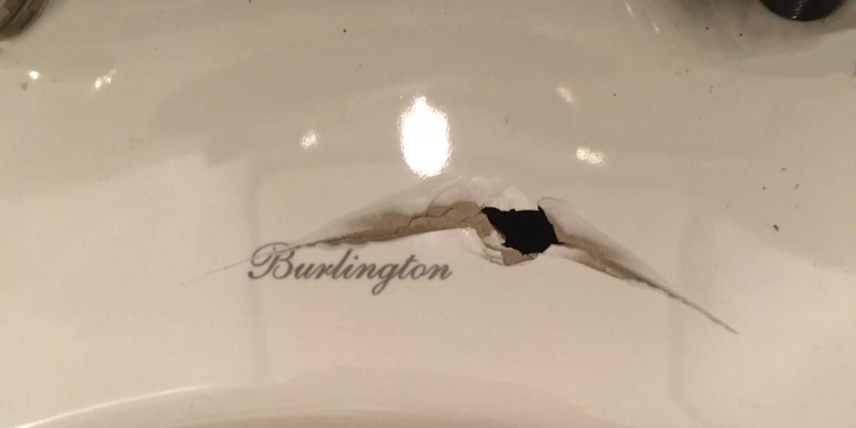 Damaged toilet pre repair.