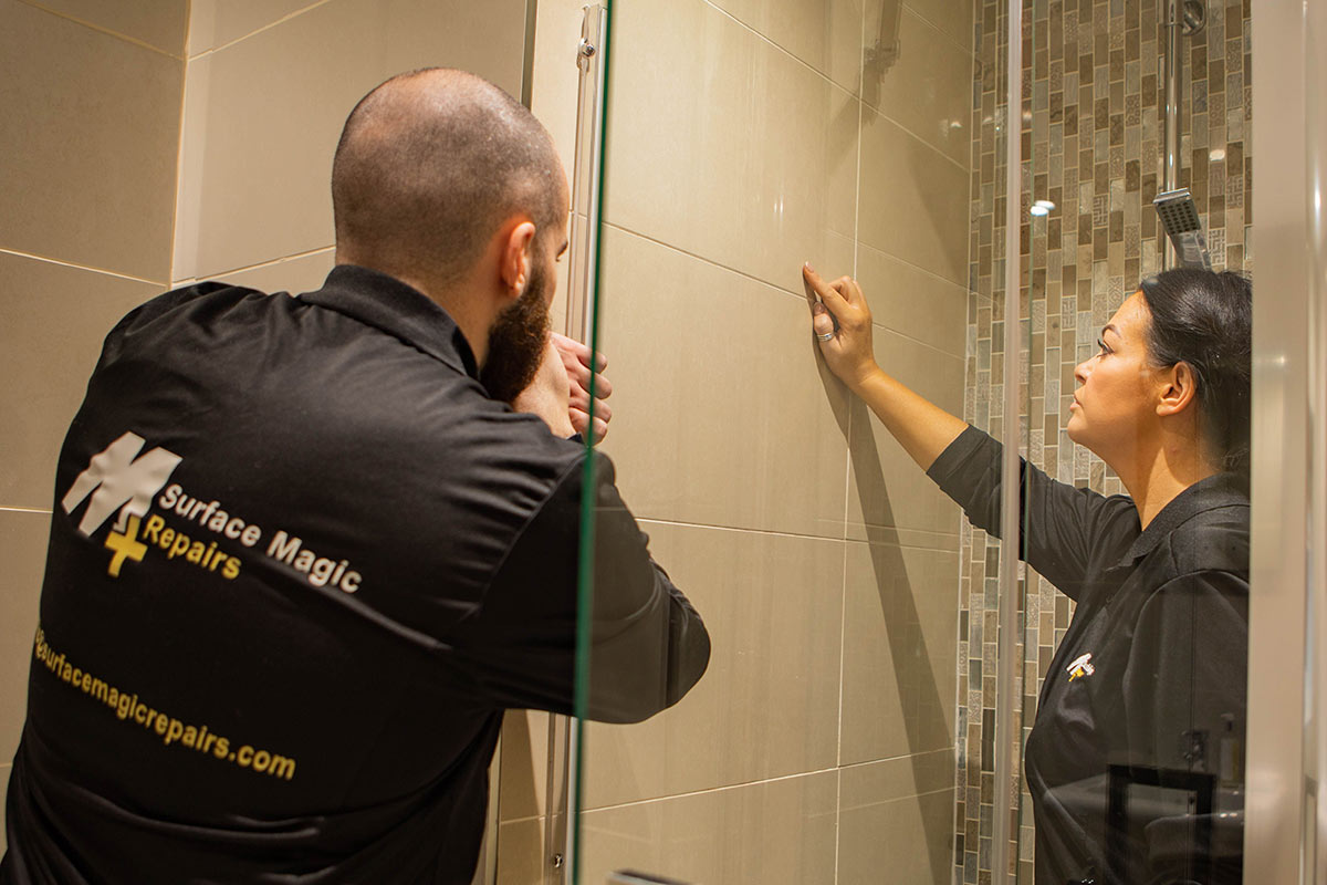 Surface Magic Repair engineers repairing shower.